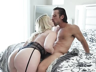 Muscular guy makes love forth busty blonde mistress upstairs bed